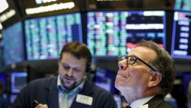Wall Street opens lower despite new Fed plan