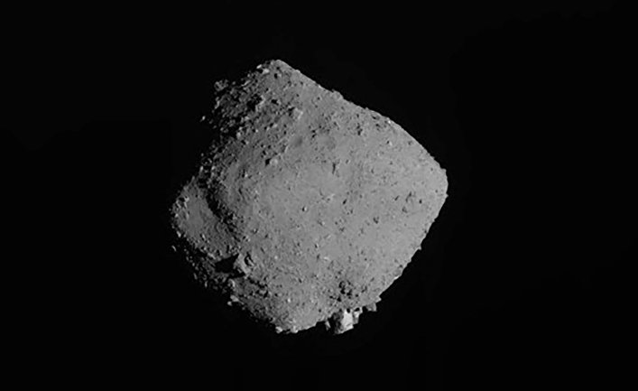 What did scientists find to an asteroid near Earth
