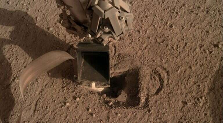 The InSight mole slowly moves deep into the surface of Mars