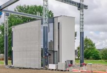 Watch a 3D printer build a two story house
