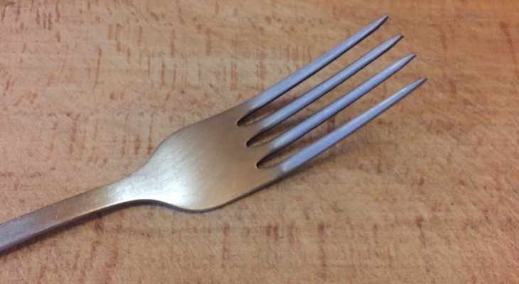 The girl accidentally swallowed a fork