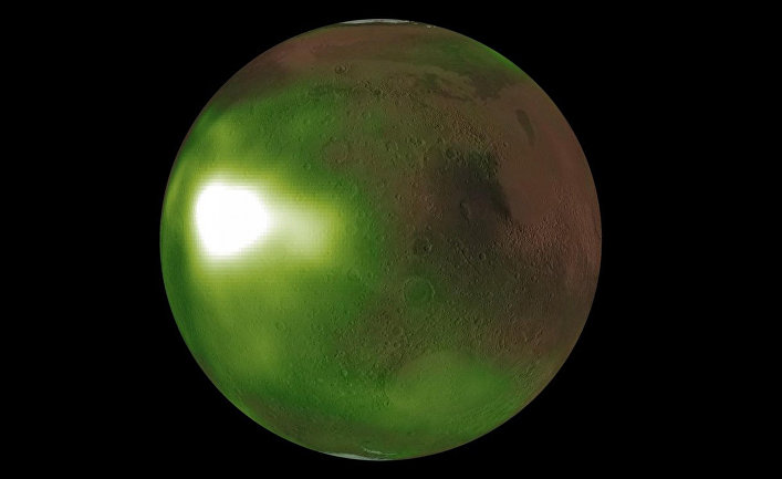 Why is Mars surrounded by a green glow in recent NASA images