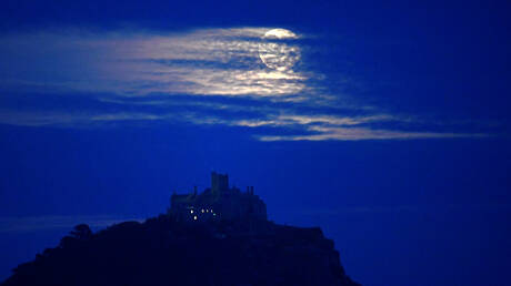 The sky celebrates Halloween with a display that combines the rare blue moon with a comet and the planet Uranus