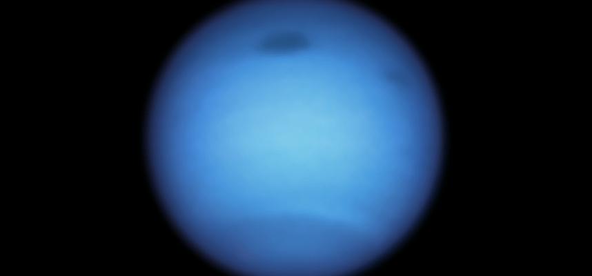 Dark vortex on Neptune changes direction unpredictably