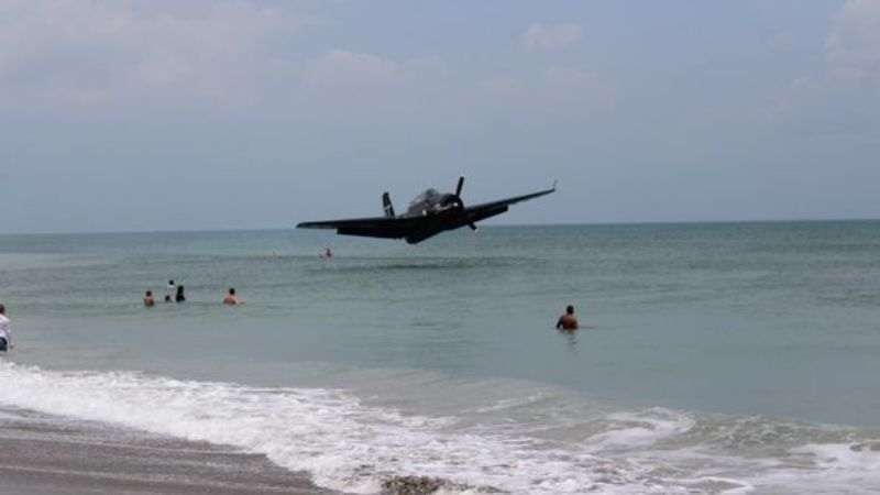 Military plane makes an emergency landing on a beach in Florida