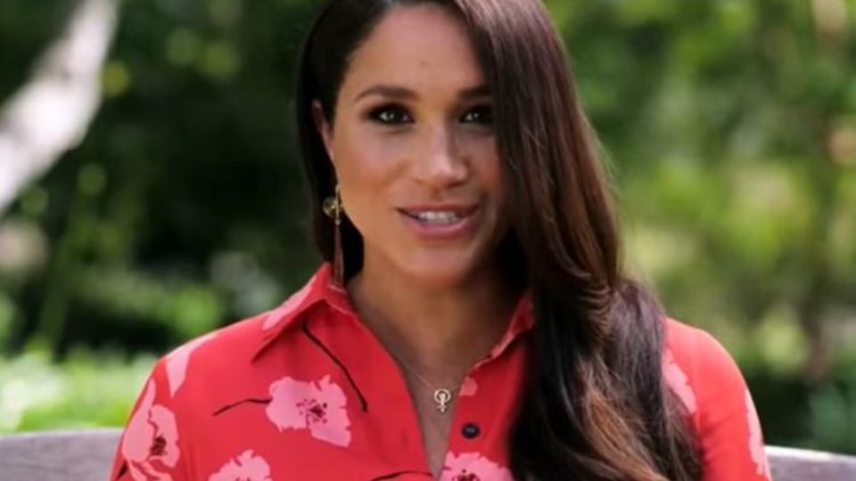 The meaning of Meghan Markles raised fist decoration revealed