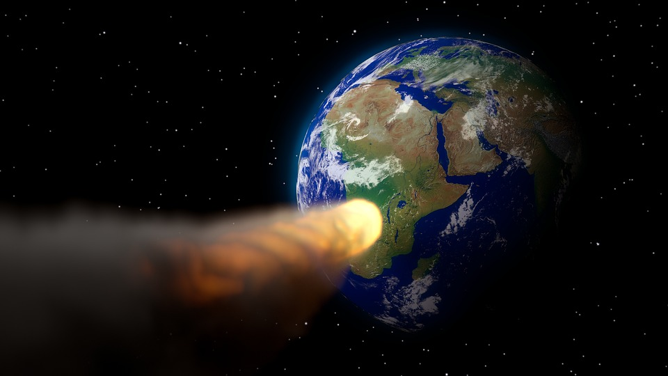 A kilometer long asteroid is approaching the Earth at high speed
